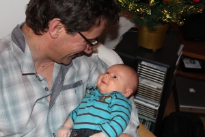"My son, smiling up at his ""Papi"" (grandfather)."