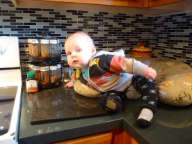 Sitting on the counter while mommy was preparing some things for lunch.