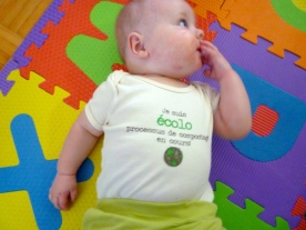 "Sporting his new onesie. It reads: "" I am ecological. Composting in progress""."