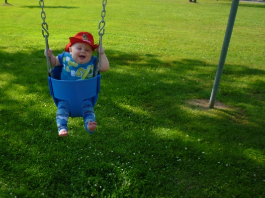 Having buckets of fun in the swing at the park last weekend.