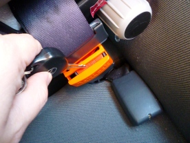 Quickly unclasping the seatbelt with the help of a key.