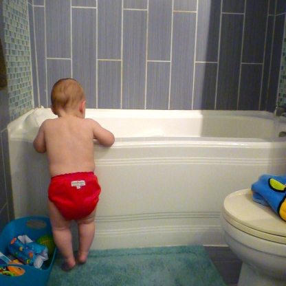 Waiting for the tub to fill.