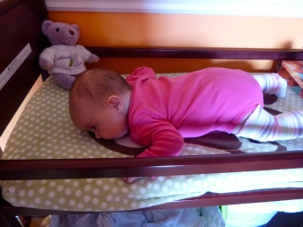 On the changing mat after each diaper change.