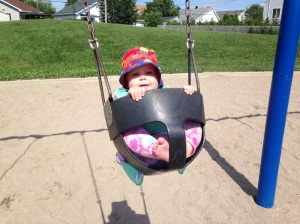 Notice the feet inside the swing.  This is her preferred method.